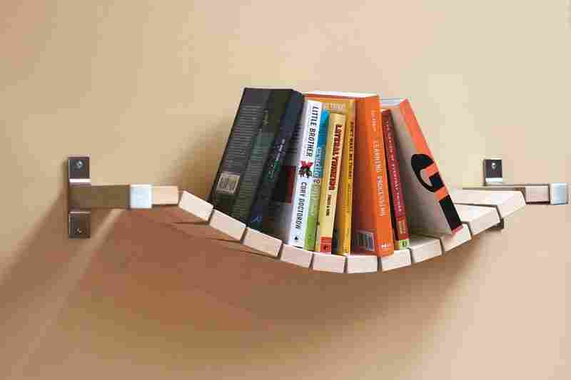 """Rope Bridge Bookshelf: """"Most bookshelves require bookends to keep the books up,"""" says designer Ed Lewis, """"but I thought that a more relaxed approach would keep them all pushed to the middle, thus the Rope Bridge Bookshelf."""""""