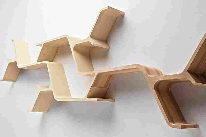 Sinapsi: Sebastian Errazuriz's design is inspired by neurons receiving electrical and chemical impulses, a process he likens to bookshelves receiving books and absorbing them into their environment.