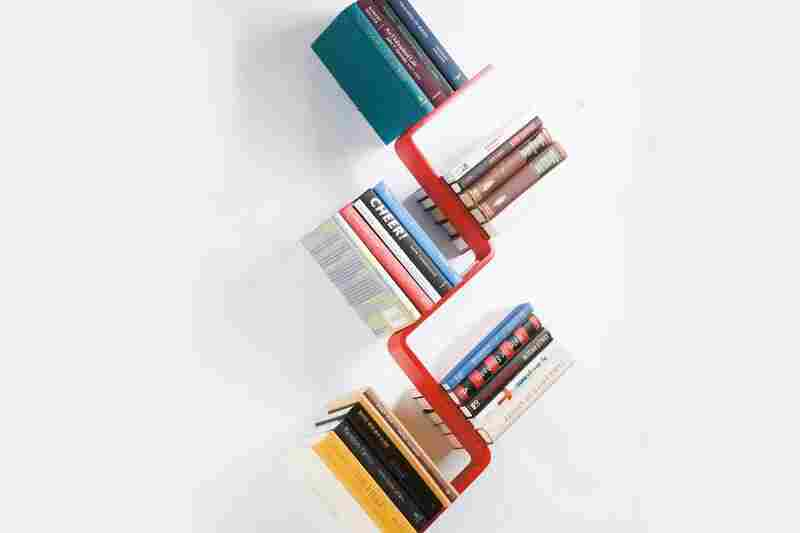 Z Shelf: The Z Shelf seems to hold books at impossible angles. Two tiny hooks hold the lower cover of the bottom book, rendering the shelf inside invisible.
