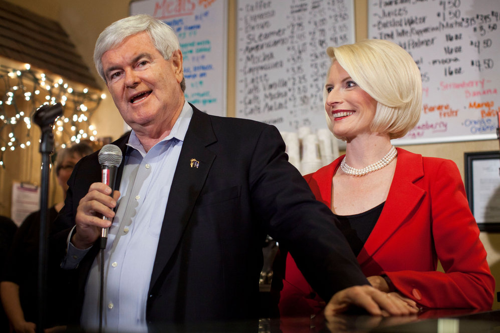 With his wife, Callista, Gingrich speaks at Adams Street Espresso on Dec. 30, 2011, in Creston, Iowa.