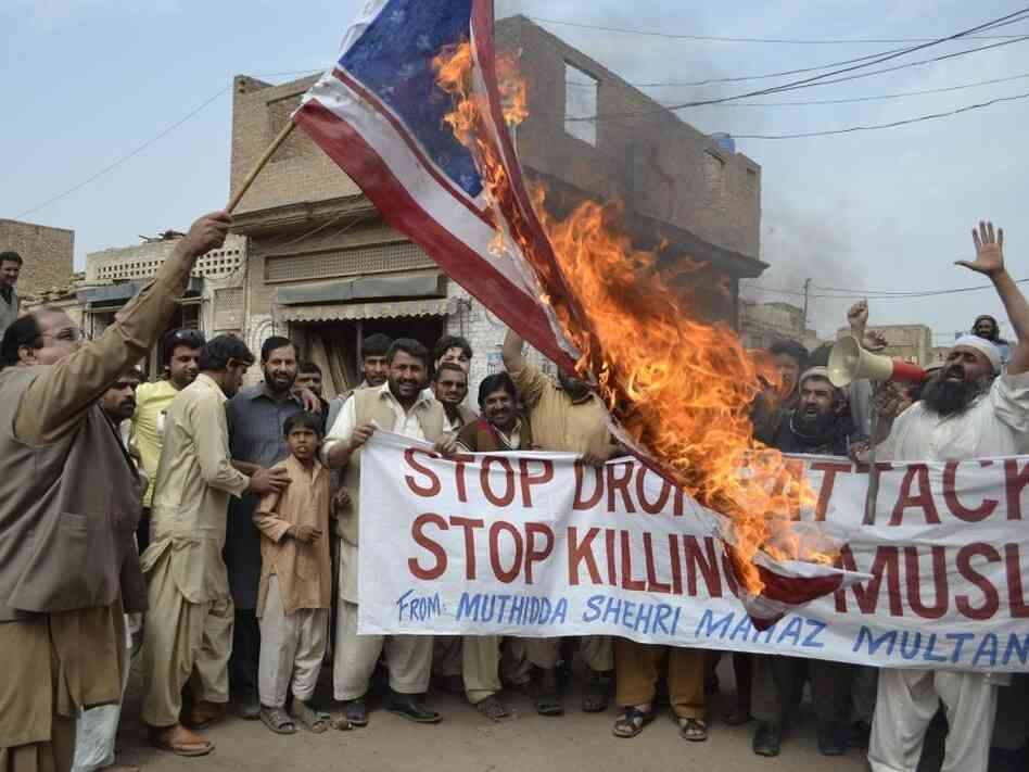 Activists of Pakistan;s Muthidda Shehri Mahaz burn the U.S. flag during a protest in Multan on March 14, 2012, against drone attacks.