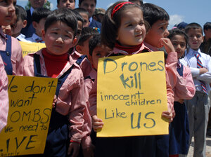 Pakistani school children carry placards during a protest at the site of the demolished compound of slain Al-Qaeda leader Osama bin Laden in northern Abbottabad on May 2, 2012 on the first anniversary of the death of Osama bin Laden.
