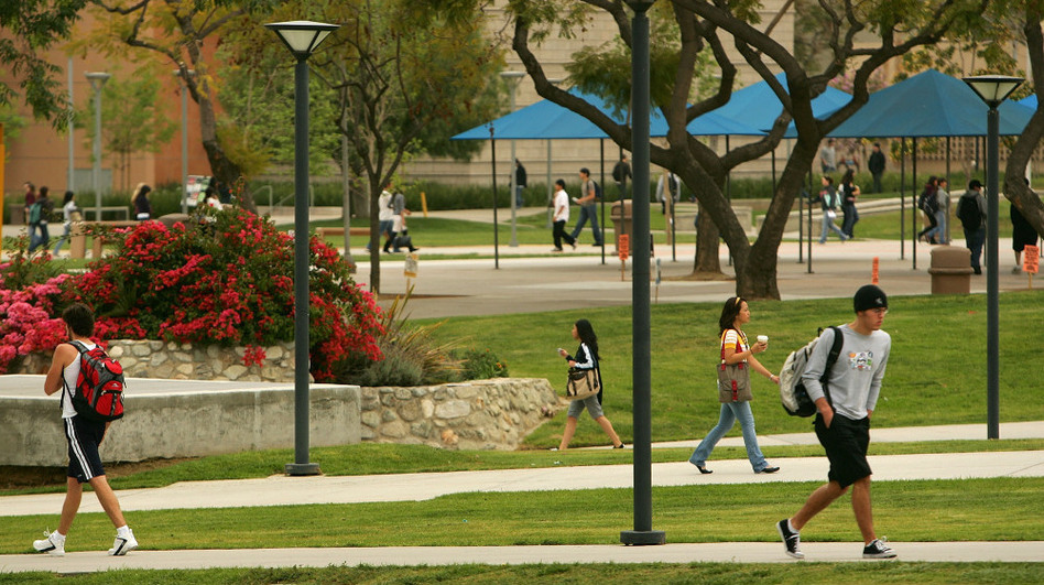 Students walk between classes at California State University, Fullerton. Because of cuts, some students have trouble getting into classes they need to graduate.