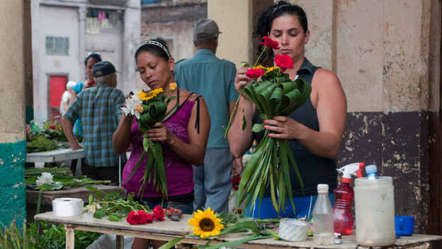 Two self-employed florists prepare bunches of flowers in Havana last year. The Cuban government is stepping up economic reforms and estimates that in four or five years, nearly half the workforce will be employed in the private sector. (AFP/Getty Images)