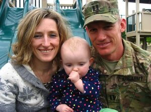 Jessie Knadler, her husband Jake (a veteran of the Army Reserves who recently returned from a deployment in Afghanistan), and their daughter June.