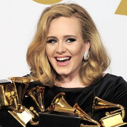 Adele poses backstage with her six awards at the 54th annual Grammy Awards on Feb. 12 in Los Angeles. Research suggests that in a wide variety of professions, including entertainment, a small but significant number of individuals perform exceedingly well and the rest of individuals' performance trails off.