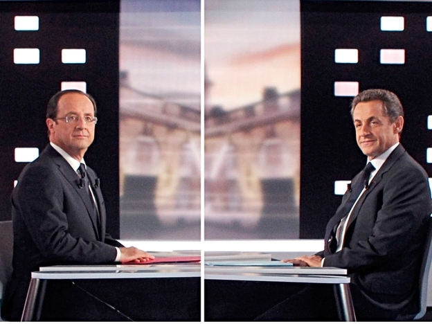 Socialist Francois Hollande, (left) and France's incumbent president, Nicolas Sarkozy, pose for photos before facing off during a contentious debate Wednesday on national TV. Opinion polls favor Hollande heading into Sunday's election.