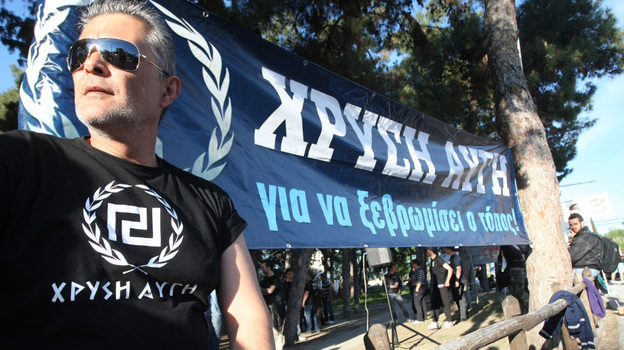 A member of the Golden Dawn far-right political organization takes part in a demonstration in Peraia, a suburb outside Thessaloniki, on April 26. Some polls indicate that in the national elections May 6, Golden Dawn may surpass the 3 percent threshold needed to enter Parliament. (AFP/Getty Images)