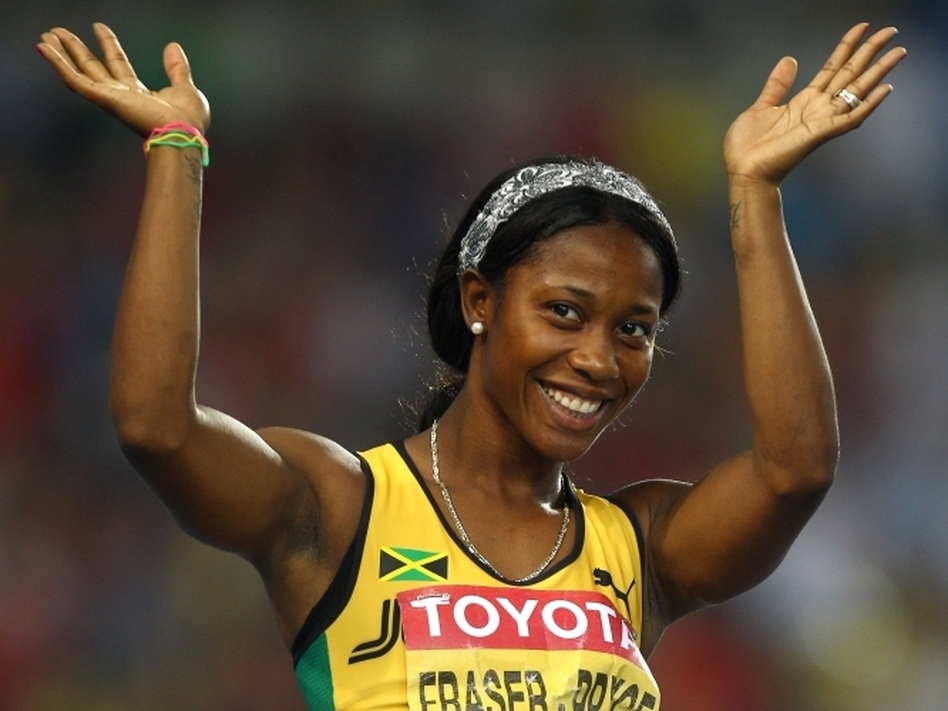 Shelly-Ann Fraser-Pryce waves after competing in the 100-meter semifinal at the World Athletics Championships in South Korea last year. Fraser-Pryce won gold at the 2008 Olympics, and is viewed as a hero by the Jamaican children she sometimes shares a track with. (Bongarts/Getty Images)