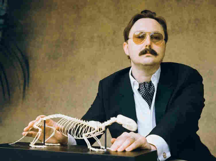 """I could be wrong, you know:"" John Hodgman notes that while his book That Is All is intensely concerned with ""the coming global superpocalypse,"" it also contains much information about travel and sports and wine, and is ""not depressing."""