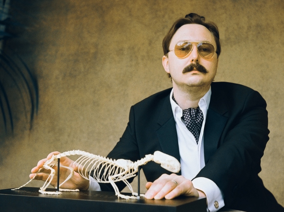 """<strong><em>I could be wrong, you know:</em></strong>"" John Hodgman notes that while his book <em>That Is All</em> is intensely concerned with ""the coming global superpocalypse,"" it also contains much information about travel and sports and wine, and is ""not depressing."""