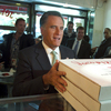 The same day President Obama made a surprise trip to Afghanistan, Mitt Romney picked up pizza for firefighters with former New York City Mayor Rudolph Giuliani.