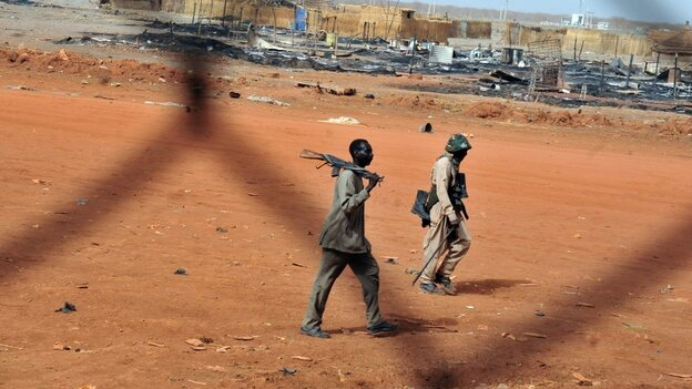Sudanese soldiers walk in the oil town of Heglig on April 24. South Sudanese forces occupied Heglig