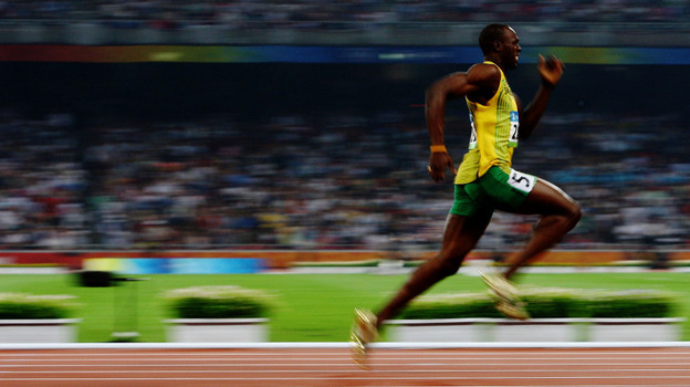 Jamaica's Usain Bolt shattered world records in the 100 and 200 meter races at the 2008 Beijing Olympics. Shown here in the 200 meters at Beijing, he's looking to repeat this summer at the London Olympics and add another chapter to Jamaica's great tradition of sprinting. (Getty Images)