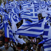 Supporters of the right-wing splinter Independent Greeks party wave flags during an election rally in the northern Greek city of Thessaloniki,  May 2, 2012. Panos Kammenos' party and other anti-bailout parties have made a strong showing in opinion polls ahead of the May 6 general election.