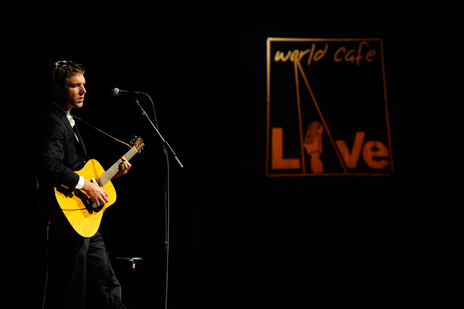 Walkmen frontman Hamilton Leithauser and the World Cafe Live sign do a heartbreaking duet about the forbidden love between a man and iconography. (Joe Del Tufo for NPR)