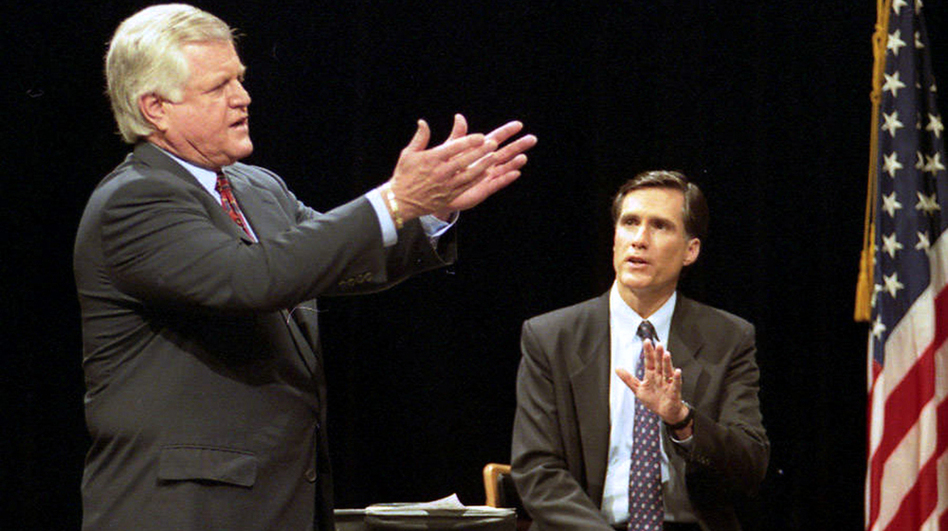 Sen. Ted Kennedy, D-Mass., and Republican challenger Mitt Romney (right) take part in a televised debate at Holyoke Community College in Holyoke, Mass., in 1994. Romney lost to Kennedy in his first political race. (Charles Krupa/AP)