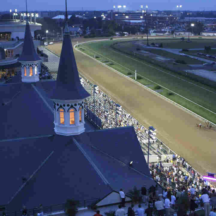 The field of horses charges down the stretch in the seventh race at Churchill Downs in Louisville, Ky., on June 19, 2009. The day marked the first night racing at the storied track in its 135-year history. Track superintendent Butch Lehr is retiring after Saturday's race. He's been maintaining the track since 1982.
