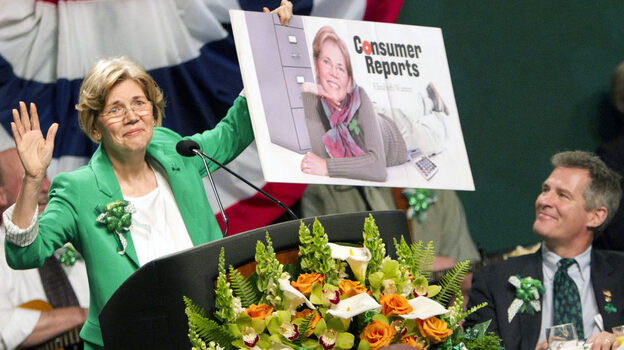 Democratic Senate candidate Elizabeth Warren holds up a poster of herself as Sen. Scott Brown, R-Mass., looks on during the annual St. Patrick's Day Breakfast in Boston on March 18. A civility pledge between the candidates has kept attack ads largely on the sidelines in their race. (AP)