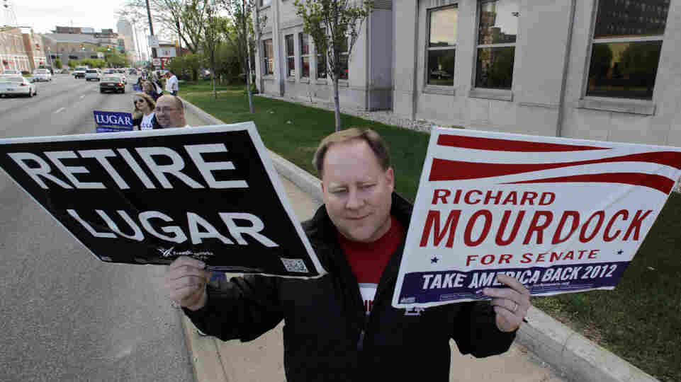 Brent Gentry shows his support for Richard Mourdock before a U.S. Senate debate on April 11 in Indianapolis.