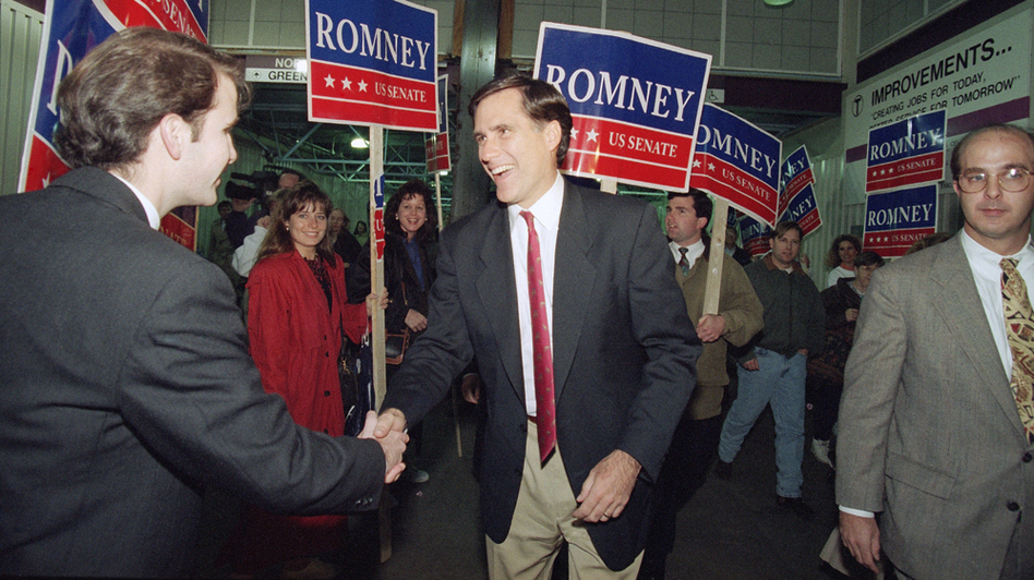 Then a Republican candidate for the U.S. Senate, Mitt Romney shakes the hand of a commuter while campaigning at North Station in Boston on Nov. 7, 1994. (AP)