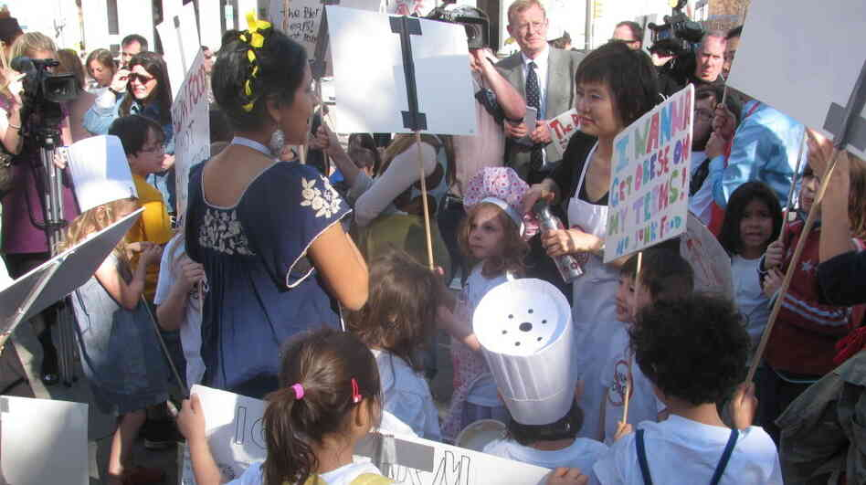 "Moms and their kids protest a proposed ban on homemade food at bake sales in New York City schools at a rally near City Hall in 2010. One sign read, ""I wanna g"