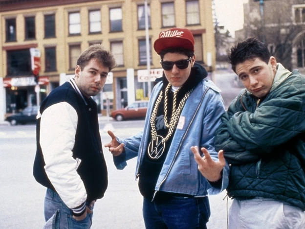 Adam Yauch (left) with the Beastie Boys in 1987. The gruff-voiced rapper known as MCA died Friday after a battle with cancer.