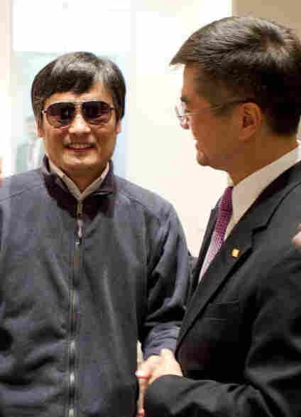 Chen Guangcheng, left, with U.S. Ambassador Gary Locke on Tuesday at the U.S. embassy in Beijing.