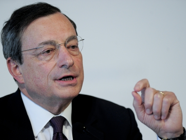 European Central Bank President Mario Draghi speaks at a news conference in Barcelona on Thursday. Central bank chiefs gathered under tight security in Spain to discuss whether to provide more easy money for governments as the political resolve to rein in deficits showed signs of crumbling.