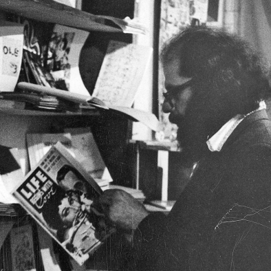 Allen Ginsberg browses at the Peace Eye bookstore.