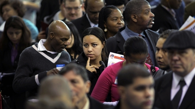 People wait at a job fair in New York City's Queens borough on Thursday. While millions of out-of-work Americans continue to seek employment, others have given up looking. (Getty Images)