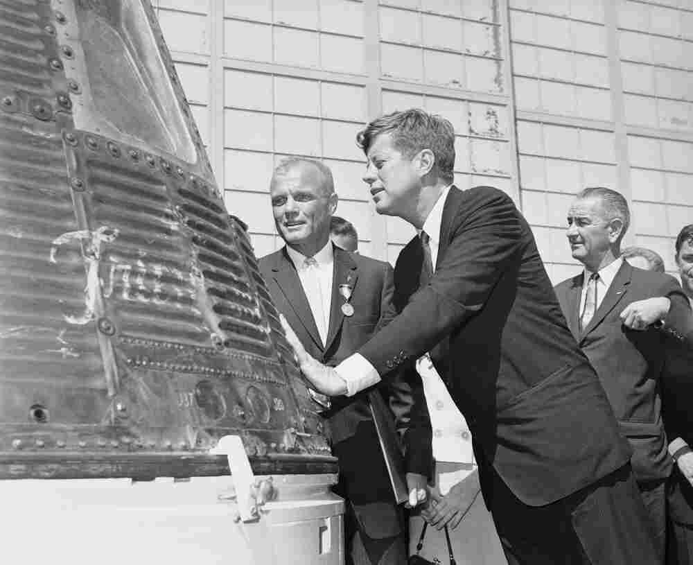 Astronaut John Glenn (left) and President John F. Kennedy inspect the Friendship 7 Mercury capsule on Feb. 23, 1962, which Glenn rode in orbit. At right is Vice President Lyndon B. Johnson.