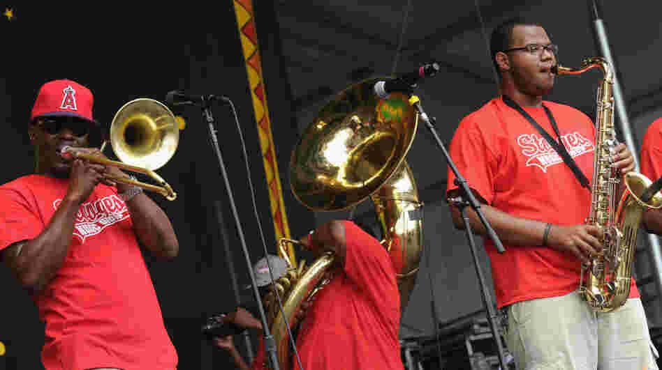 The Stooges Brass Band performs during the 2012 New Orleans Jazz & Heritage Festival.