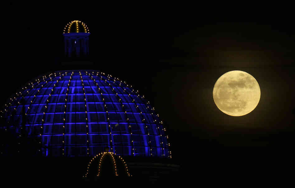 A super moon rises above a shopping center in Manchester, Britain, on March 19, 2011.