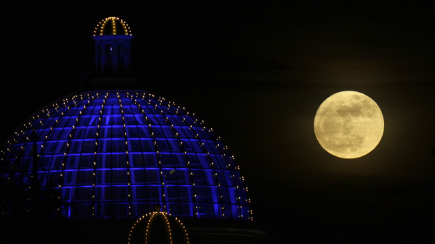 A super moon rises above a shopping center in Manchester, Britain, on March 19, 2011. (AP)