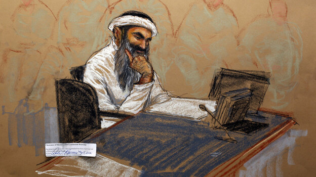 Khalid Sheikh Mohammed reads a document during his arraignment at the Guantanamo Bay U.S. Naval Base in Cuba.