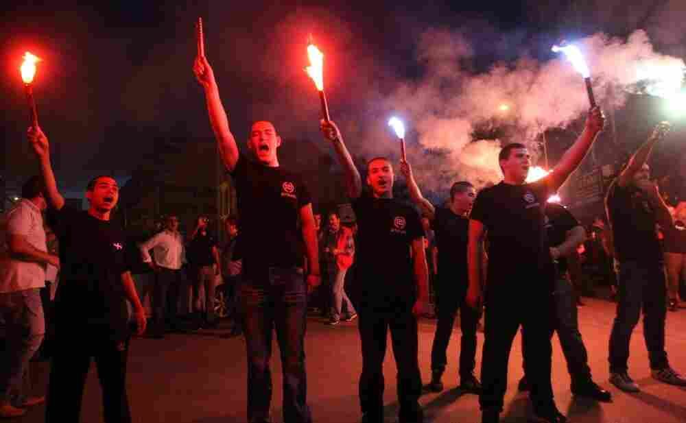 Members of the Greek neo-Nazi Golden Dawn Party celebrate in Thessaloniki on Sunday. Golden Dawn is now set to enter parliament for the first time since the end of the military junta in 1974.