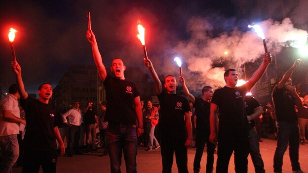 Members of the Greek neo-Nazi Golden Dawn Party celebrate in Thessaloniki on Sunday. Golden Dawn is now set to enter parliament for the first time since the end of the military junta in 1974. (AFP/Getty Images)