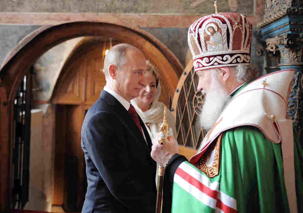 Russia's President Vladimir Putin and his wife Lyudmila speak with Russian Orthodox Church head, Patriarch Kirill, during a service at Blagoveshchensky (the Annunciation) cathedral after Putin's inauguration ceremony. Putin took his oath of office today to become Russia's president for a historic third mandate at a glittering ceremony inside the Kremlin.
