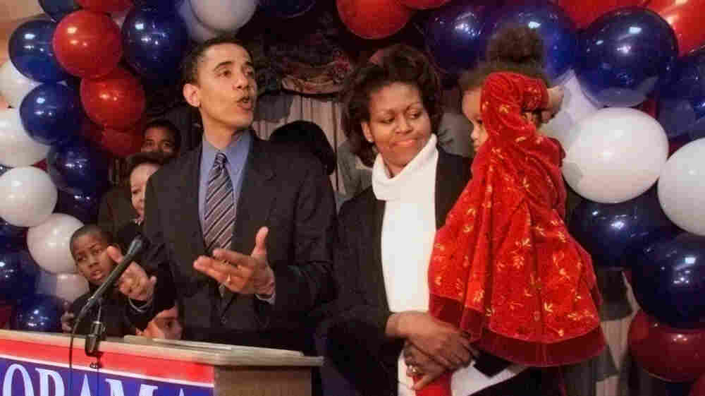 Barack Obama, then a Democratic candidate for a U.S. House seat, delivers his concession speech to supporters, while his wife, Michelle, tends to their daughter, Malia, on March 21, 2000, in Chicago.
