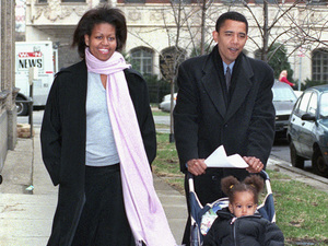 Then-Illinois state Sen. Barack Obama walks with his wife, Michelle, and daughter, Malia, age 1 1/2, in Chicago on primary day in March 2000. Obama lost to incumbent U.S. Rep. Bobby Rush in the primary.