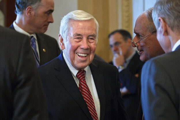 Sen. Richard Lugar, R-Ind., 80, faces a GOP primary battle Tuesday that could end his political career. Here, Lugar talks with Capitol Hill colleagues on March 6.  (AP)