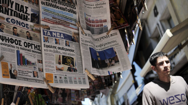 Greek newspapers on display at a newsstand in Athens on Monday after a stunning weekend election shake-up by parties opposed to further vital austerity cuts.