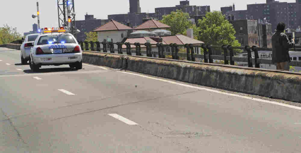 Skid marks left by a van are visible on a highway after a van plunged over both the concrete and iron railing, killing three generations of a Bronx family, in New York.