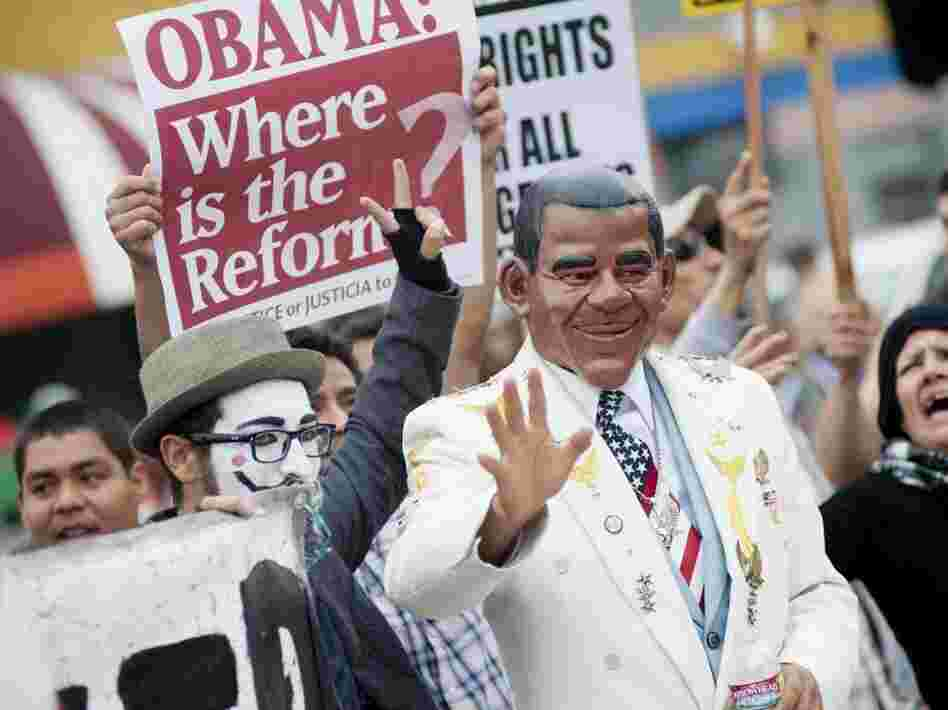 A May Day activist dressed as President Barack Obama marches through downtown Los Angeles marking the International Worker's Day on May 1, 2012 in Los Angeles, California. Despite some calling the president a populist, he has had trouble courting Wall Street.
