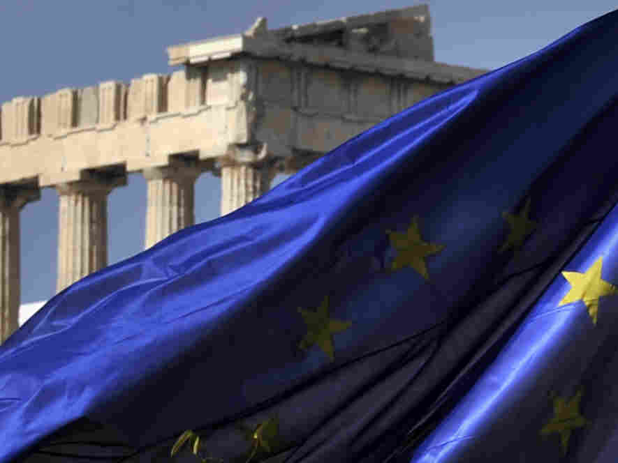 The European Union flag flies in front of the Parthenon in Athens.