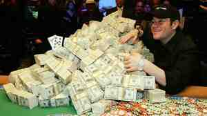 Jamie Gold of California poses with the USD 12 million he won in the World Series of Poker.