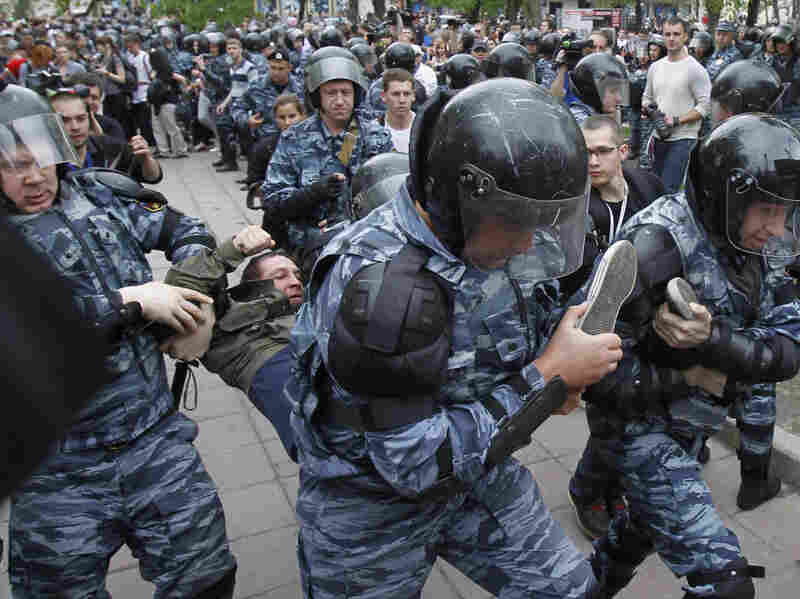 Riot police detain an opposition supporter during an anti-Putin protest in Moscow on Monday. Tens of thousands of people — mostly young Russians — turned out in protest against Putin on Sunday and Monday.