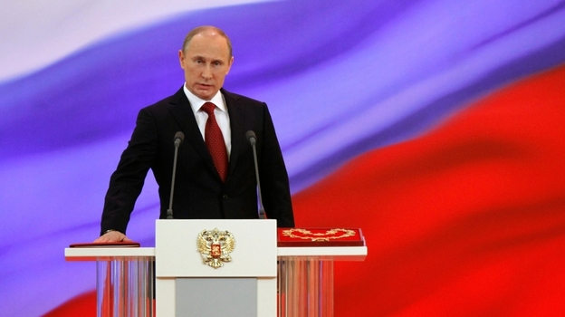 Vladimir Putin takes the oath of office during his inauguration as Russia's president at the Grand Kremlin Palace in Moscow on Monday. Putin will be serving his third term as president, after four years as prime minister and two previous presidential terms. (AP)