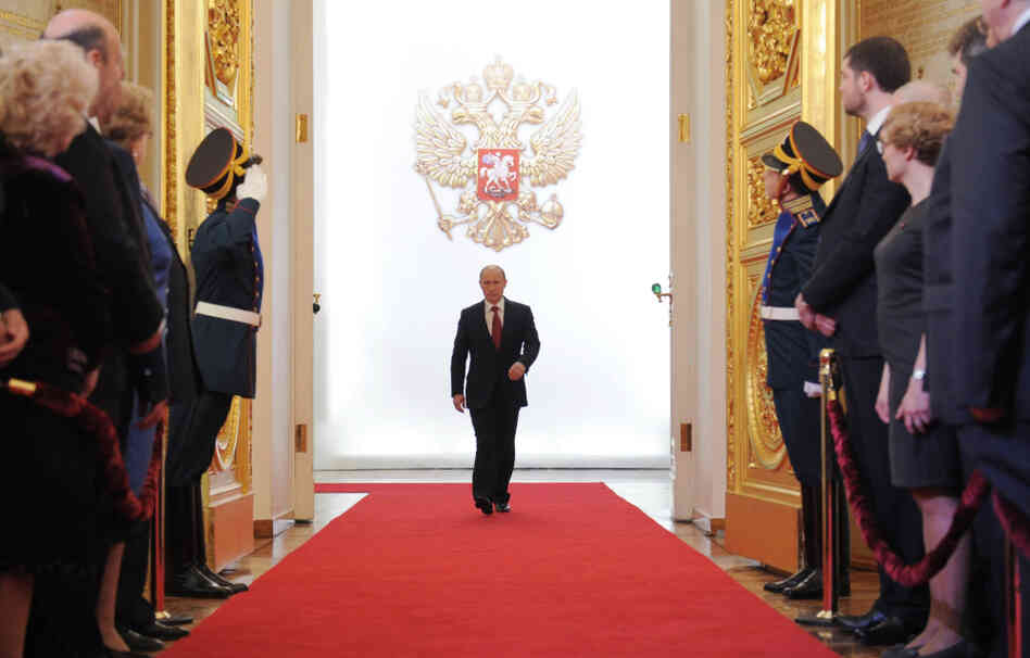 Russia's Vladimir Putin enters St. Andrew's Hall to take the oath of office during his inauguration as Russian president in the Grand Kremlin Palace in Moscow on Tuesday.
